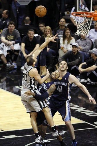 Apr 6, 2014; San Antonio, TX, USA; Memphis Grizzlies forward James Johnson (3) fouls San Antonio Spurs guard Manu Ginobili (20) during the second half at AT&T Center. The Spurs won 112-92. Mandatory Credit: Soobum Im-USA TODAY Sports