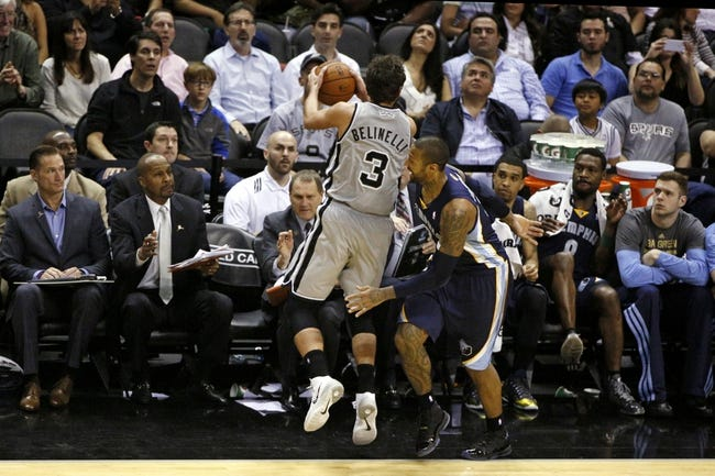 Apr 6, 2014; San Antonio, TX, USA; San Antonio Spurs forward Marco Belinelli (3) attempts to save a ball going out of bounds in front of Memphis Grizzlies forward James Johnson (3) during the second half at AT&T Center. The Spurs won 112-92. Mandatory Credit: Soobum Im-USA TODAY Sports