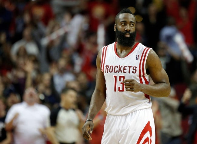 Apr 6, 2014; Houston, TX, USA; Houston Rockets guard James Harden (13) reacts to making a game tying three-pointer during the fourth quarter against the Denver Nuggets at Toyota Center. The Houston Rockets beat the Denver Nuggets in overtime 130-125. Mandatory Credit: Andrew Richardson-USA TODAY Sports
