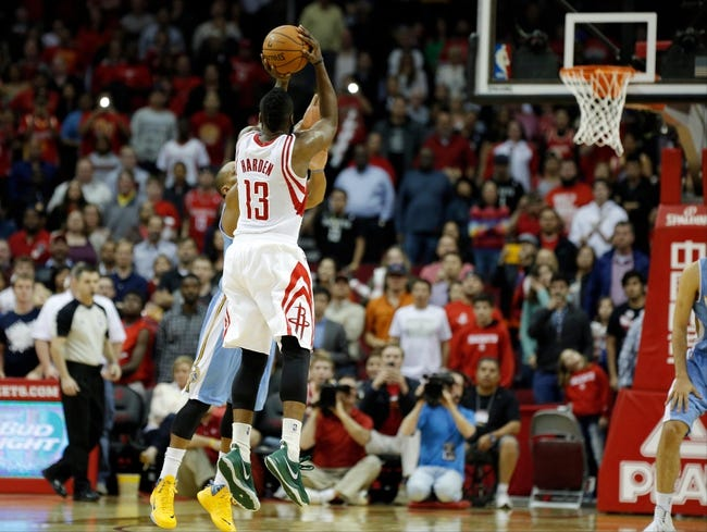 Apr 6, 2014; Houston, TX, USA; Houston Rockets guard James Harden (13) hits a three-pointer over Denver Nuggets guard Randy Foye (4) to tie the game during the fourth quarter at Toyota Center. The Houston Rockets beat the Denver Nuggets in overtime130-125.Mandatory Credit: Andrew Richardson-USA TODAY Sports