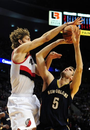Apr 6, 2014; Portland, OR, USA; Portland Trail Blazers center Robin Lopez (42) blocks the shot of New Orleans Pelicans center Jeff Withey (5) during the first quarter at Moda Center. Mandatory Credit: Steve Dykes-USA TODAY Sports