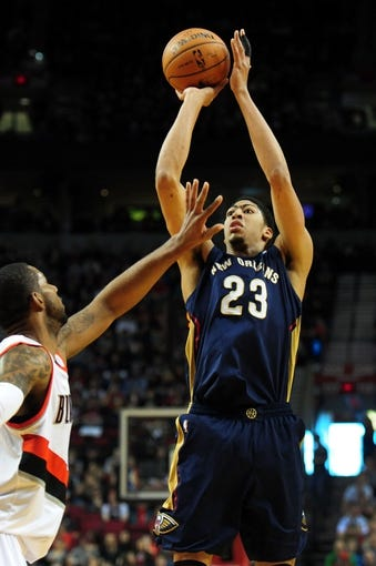 Apr 6, 2014; Portland, OR, USA; New Orleans Pelicans forward Anthony Davis (23) shoots the ball over Portland Trail Blazers forward LaMarcus Aldridge (12) during the first quarter at Moda Center. Mandatory Credit: Steve Dykes-USA TODAY Sports