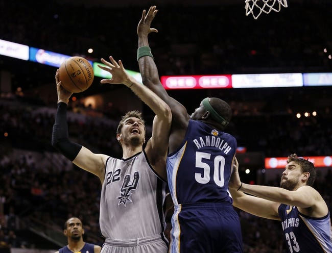 Apr 6, 2014; San Antonio, TX, USA; San Antonio Spurs forward Tiago Splitter (22) shoots as Memphis Grizzlies forward Zach Randolph (50) defends during the first half at AT&T Center. Mandatory Credit: Soobum Im-USA TODAY Sports