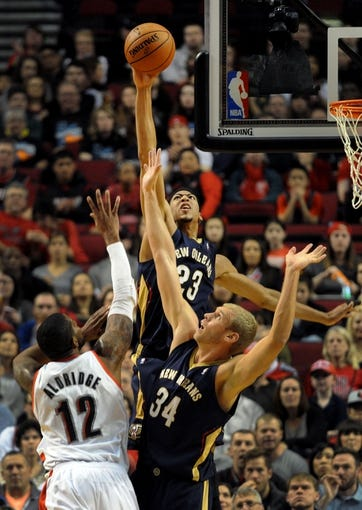Apr 6, 2014; Portland, OR, USA; New Orleans Pelicans forward Anthony Davis (23) blocks the shot of Portland Trail Blazers forward LaMarcus Aldridge (12) as New Orleans Pelicans center Greg Stiemsma (34) defends during the first quarter at Moda Center. Mandatory Credit: Steve Dykes-USA TODAY Sports