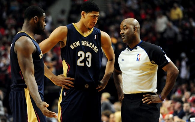 Apr 6, 2014; Portland, OR, USA; New Orleans Pelicans forward Tyreke Evans (1) and forward Anthony Davis (23) s[eak with referee Haywoode Workman (66) during the third quarter of the game against the Portland Trail Blazers at the Moda Center. The Blazers won the game 100-94. Mandatory Credit: Steve Dykes-USA TODAY Sports