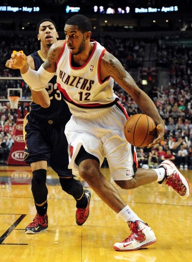 Apr 6, 2014; Portland, OR, USA;Portland Trail Blazers forward LaMarcus Aldridge (12) drives to the basket on New Orleans Pelicans forward Anthony Davis (23) during the third quarter of the game at the Moda Center. The Blazers won the game 100-94. Mandatory Credit: Steve Dykes-USA TODAY Sports