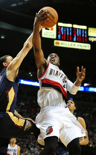 Apr 6, 2014; Portland, OR, USA; Portland Trail Blazers guard Wesley Matthews (2) drives to the basket on New Orleans Pelicans guard Austin Rivers (25) during the fourth quarter of the game at the Moda Center. The Blazers won the game 100-94. Mandatory Credit: Steve Dykes-USA TODAY Sports