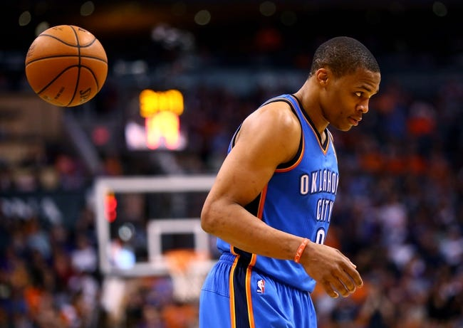 Apr 6, 2014; Phoenix, AZ, USA; Oklahoma City Thunder guard Russell Westbrook in the second half against the Phoenix Suns at US Airways Center. The Suns defeated the Thunder 122-115. Mandatory Credit: Mark J. Rebilas-USA TODAY Sports