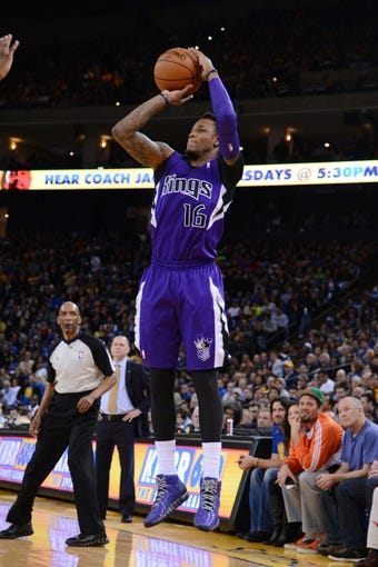 April 4, 2014; Oakland, CA, USA; Sacramento Kings guard Ben McLemore (16) shoots the ball against the Golden State Warriors during the second quarter at Oracle Arena. The Warriors defeated the Kings 102-69. Mandatory Credit: Kyle Terada-USA TODAY Sports