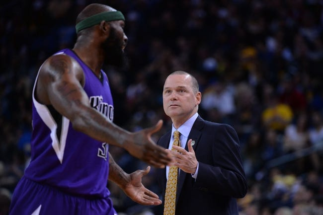 April 4, 2014; Oakland, CA, USA; Sacramento Kings head coach Michael Malone (right) talks to forward Reggie Evans (30, left) against the Golden State Warriors during the third quarter at Oracle Arena. The Warriors defeated the Kings 102-69. Mandatory Credit: Kyle Terada-USA TODAY Sports