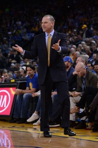 April 4, 2014; Oakland, CA, USA; Sacramento Kings head coach Michael Malone reacts against the Golden State Warriors during the first quarter at Oracle Arena. The Warriors defeated the Kings 102-69. Mandatory Credit: Kyle Terada-USA TODAY Sports