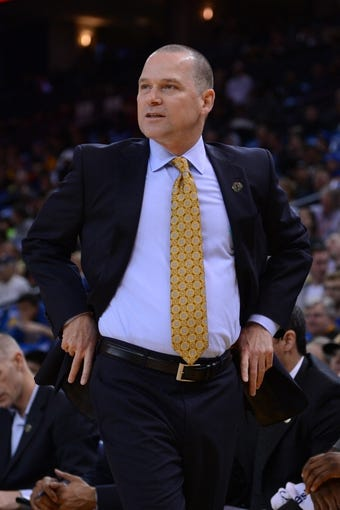 April 4, 2014; Oakland, CA, USA; Sacramento Kings head coach Michael Malone looks on against the Golden State Warriors during the first quarter at Oracle Arena. The Warriors defeated the Kings 102-69. Mandatory Credit: Kyle Terada-USA TODAY Sports