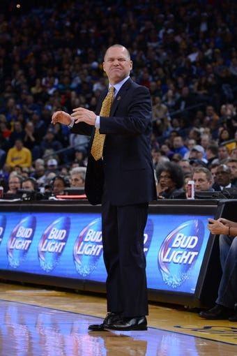 April 4, 2014; Oakland, CA, USA; Sacramento Kings head coach Michael Malone reacts against the Golden State Warriors during the second quarter at Oracle Arena. The Warriors defeated the Kings 102-69. Mandatory Credit: Kyle Terada-USA TODAY Sports