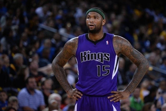 April 4, 2014; Oakland, CA, USA; Sacramento Kings center DeMarcus Cousins (15) looks on against the Golden State Warriors during the third quarter at Oracle Arena. The Warriors defeated the Kings 102-69. Mandatory Credit: Kyle Terada-USA TODAY Sports