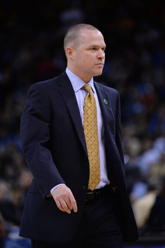 April 4, 2014; Oakland, CA, USA; Sacramento Kings head coach Michael Malone looks on against the Golden State Warriors during the second quarter at Oracle Arena. The Warriors defeated the Kings 102-69. Mandatory Credit: Kyle Terada-USA TODAY Sports