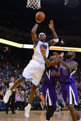 April 4, 2014; Oakland, CA, USA; Golden State Warriors center Jermaine O'Neal (7) shoots the ball against the Sacramento Kings during the third quarter at Oracle Arena. The Warriors defeated the Kings 102-69. Mandatory Credit: Kyle Terada-USA TODAY Sports