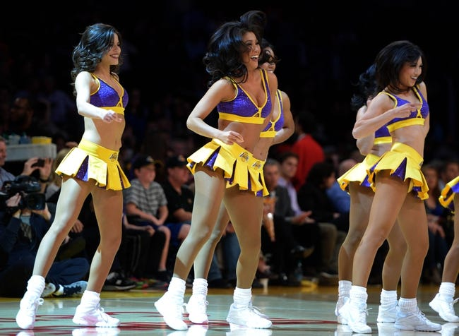 Apr 4, 2014; Los Angeles, CA, USA; Los Angeles Lakers girls cheerleaders perform during the game against the Dallas Mavericks at Staples Center. Mandatory Credit: Kirby Lee-USA TODAY Sports