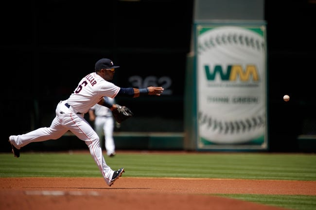 Apr 7, 2014; Houston, TX, USA; Houston Astros shortstop Jonathan Villar (6) tosses the ball to first base during the first inning against the Los Angeles Angels at Minute Maid Park. Mandatory Credit: Andrew Richardson-USA TODAY Sports