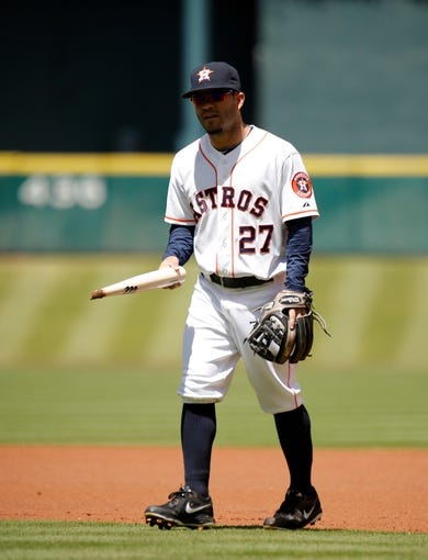 Apr 7, 2014; Houston, TX, USA; Houston Astros second baseman Jose Altuve (27) removes a piece of a broken bat from where it was stuck in the field during the first inning against the Los Angeles Angels at Minute Maid Park. Mandatory Credit: Andrew Richardson-USA TODAY Sports