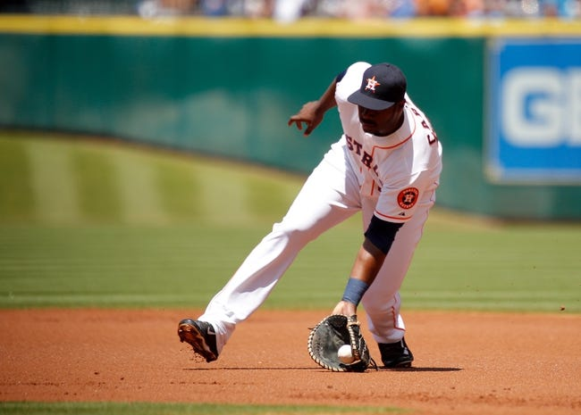 Apr 7, 2014; Houston, TX, USA; Houston Astros first baseman Chris Carter (23) fields a ground ball during the first inning against the Los Angeles Angels at Minute Maid Park. Mandatory Credit: Andrew Richardson-USA TODAY Sports