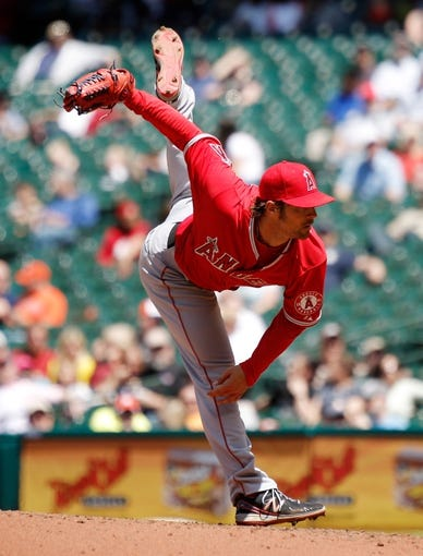 Apr 7, 2014; Houston, TX, USA; Los Angeles Angels starting pitcher C.J. Wilson (33) pitches during the fourth inning against the Houston Astros at Minute Maid Park. Mandatory Credit: Andrew Richardson-USA TODAY Sports
