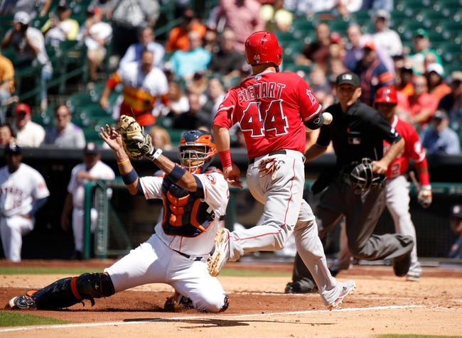 Apr 7, 2014; Houston, TX, USA; Houston Astros catcher Carlos Corporan (22) is unable to tag Los Angeles Angels third baseman Ian Stewart (44) during the sixth inning at Minute Maid Park. Mandatory Credit: Andrew Richardson-USA TODAY Sports