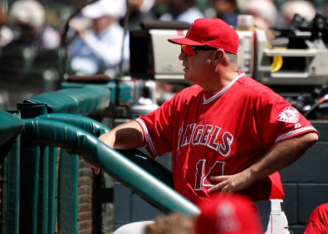 Apr 7, 2014; Houston, TX, USA; Los Angeles Angels manager Mike Scioscia (14) watches from the dugout during the sixth inning against the Houston Astros at Minute Maid Park. Mandatory Credit: Andrew Richardson-USA TODAY Sports
