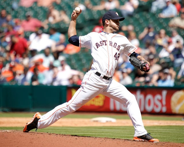 Apr 7, 2014; Houston, TX, USA; Houston Astros starting pitcher Jarred Cosart (48) pitches during the sixth inning against the Los Angeles Angels at Minute Maid Park. Mandatory Credit: Andrew Richardson-USA TODAY Sports