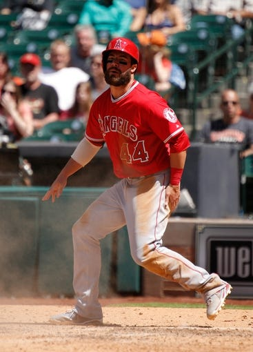 Apr 7, 2014; Houston, TX, USA; Los Angeles Angels third baseman Ian Stewart (44) scores a run during the sixth inning against the Houston Astros at Minute Maid Park. Mandatory Credit: Andrew Richardson-USA TODAY Sports