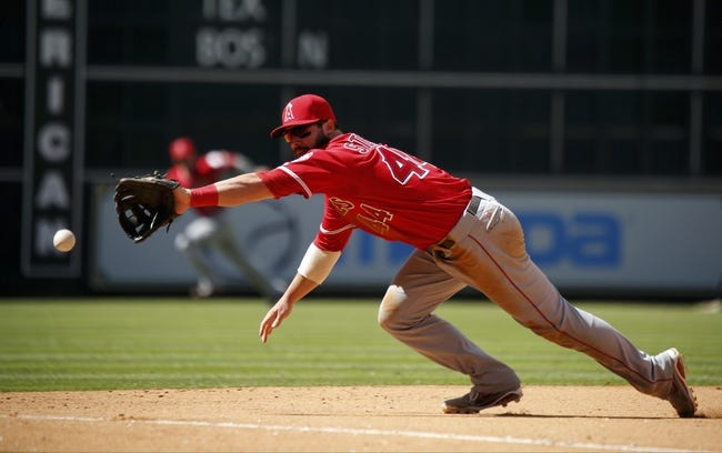 Apr 7, 2014; Houston, TX, USA; Los Angeles Angels third baseman Ian Stewart (44) dives for a ground ball during the eighth inning against the Houston Astros at Minute Maid Park. Mandatory Credit: Andrew Richardson-USA TODAY Sports