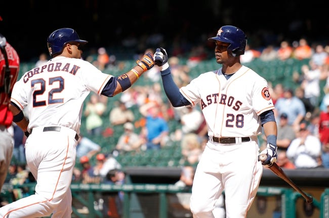 Apr 7, 2014; Houston, TX, USA; Houston Astros catcher Carlos Corporan (22) high-fives Houston Astros right fielder L.J. Hoes (28) after hitting a home run during the eighth inning at Minute Maid Park. Mandatory Credit: Andrew Richardson-USA TODAY Sports