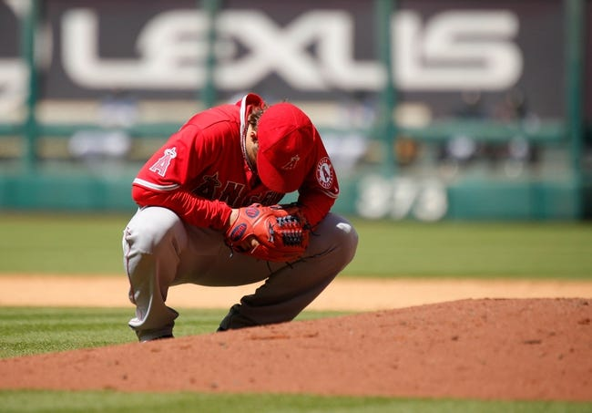 Apr 7, 2014; Houston, TX, USA; Los Angeles Angels starting pitcher C.J. Wilson (33) crouches behind the mound during the eighth inning against the Houston Astros at Minute Maid Park. Mandatory Credit: Andrew Richardson-USA TODAY Sports