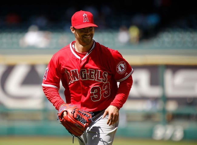 Apr 7, 2014; Houston, TX, USA; Los Angeles Angels starting pitcher C.J. Wilson (33) smiles as he runs to the dugout during the seventh inning at Minute Maid Park. Mandatory Credit: Andrew Richardson-USA TODAY Sports