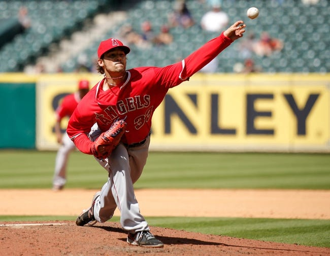 Apr 7, 2014; Houston, TX, USA; Los Angeles Angels starting pitcher C.J. Wilson (33) pitches during the seventh inning against the Houston Astros at Minute Maid Park. Mandatory Credit: Andrew Richardson-USA TODAY Sports