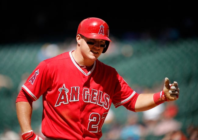 Apr 7, 2014; Houston, TX, USA; Los Angeles Angels center fielder Mike Trout (27) reacts to a call during the seventh inning against the Houston Astros at Minute Maid Park. Mandatory Credit: Andrew Richardson-USA TODAY Sports