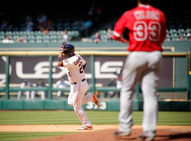 Apr 7, 2014; Houston, TX, USA; Houston Astros catcher Carlos Corporan (22) rounds the bases after hitting a home run off Los Angeles Angels starting pitcher C.J. Wilson (33) during the seventh inning at Minute Maid Park. Mandatory Credit: Andrew Richardson-USA TODAY Sports