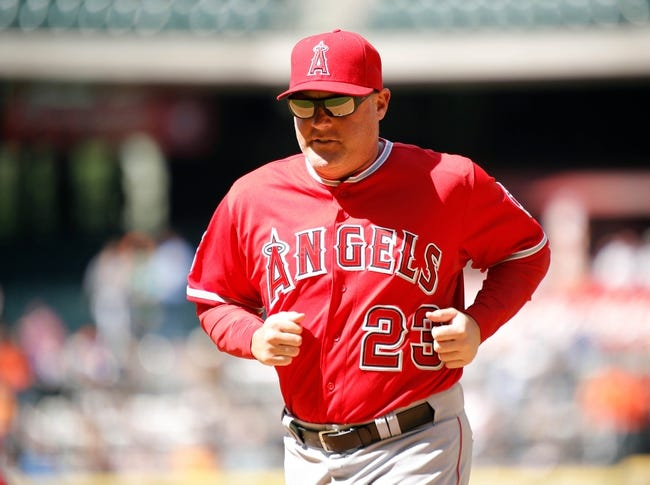 Apr 7, 2014; Houston, TX, USA; Los Angeles Angels manager Mike Scioscia (14) runs back to the dugout during the eighth inning against the Houston Astros at Minute Maid Park. Mandatory Credit: Andrew Richardson-USA TODAY Sports