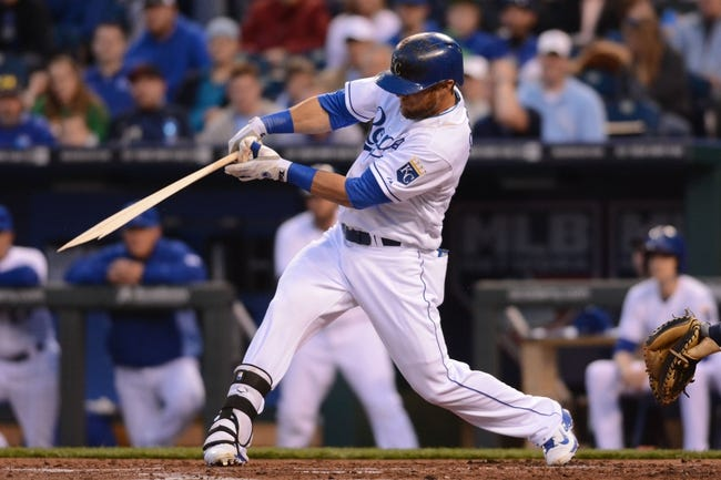 Apr 7, 2014; Kansas City, MO, USA; Kansas City Royals left fielder Alex Gordon (4) breaks his bat in the second inning against the Tampa Bay Rays at Kauffman Stadium. Mandatory Credit: Denny Medley-USA TODAY Sports