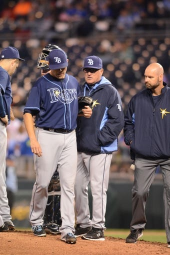 Apr 7, 2014; Kansas City, MO, USA; Tampa Bay Rays starting pitcher Matt Moore (55) leaves the field injured during the fifth inning against the Kansas City Royals at Kauffman Stadium. Mandatory Credit: Denny Medley-USA TODAY Sports