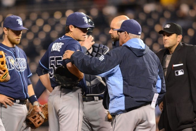 Apr 7, 2014; Kansas City, MO, USA; Tampa Bay Rays manager Joe Maddon (70) talks with starting pitcher Matt Moore (55) on the mound during the fifth inning against the Kansas City Royals at Kauffman Stadium. Mandatory Credit: Denny Medley-USA TODAY Sports