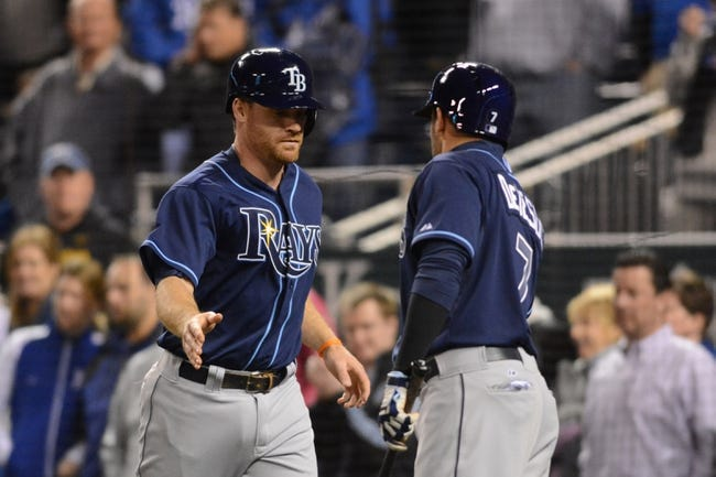 Apr 7, 2014; Kansas City, MO, USA; Tampa Bay Rays third baseman Logan Forsythe (10) is congratulated by center fielder David DeJesus (7) after scoring in the ninth inning against the Kansas City Royals at Kauffman Stadium. The Royals won 4-2.  Mandatory Credit: Denny Medley-USA TODAY Sports
