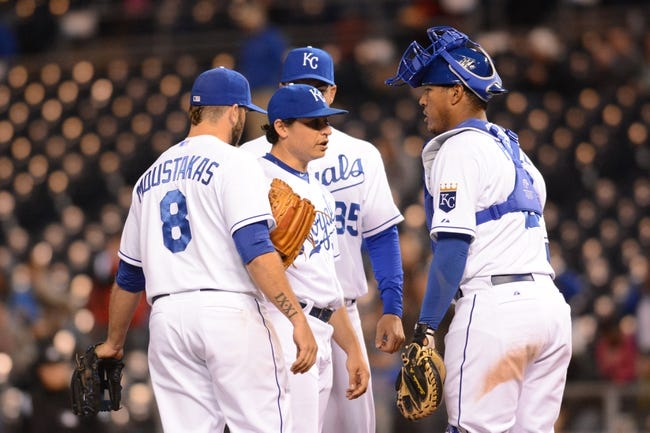 Apr 7, 2014; Kansas City, MO, USA; Kansas City Royals catcher Salvador Perez (13), third baseman Mike Moustakas (8), and first baseman Eric Hosmer (35) talk with starting pitcher Jason Vargas (51) at the mound in the ninth inning of the game against the Tampa Bay Rays at Kauffman Stadium. The Royals won 4-2.  Mandatory Credit: Denny Medley-USA TODAY Sports