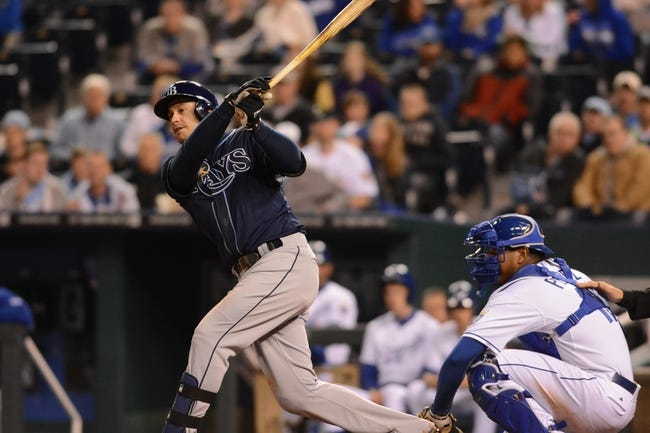 Apr 7, 2014; Kansas City, MO, USA; Tampa Bay Rays third baseman Evan Longoria (3) connects for a single in the ninth inning against the Kansas City Royals at Kauffman Stadium. The Royals won 4-2.  Mandatory Credit: Denny Medley-USA TODAY Sports