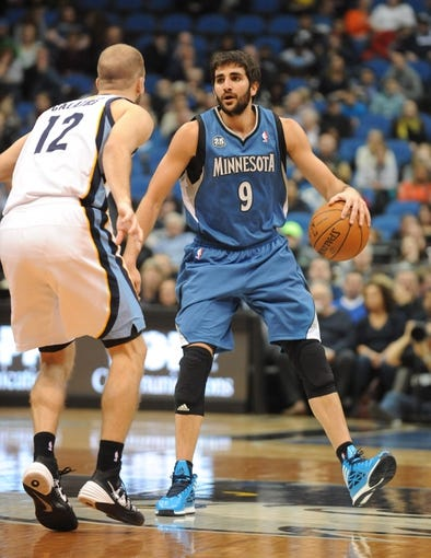 Apr 2, 2014; Minneapolis, MN, USA;  Minnesota Timberwolves guard Ricky Rubio (9) brings the ball up court in the second half against the Memphis Grizzlies at Target Center. The Wolves defeated the Grizzlies 102-88.  Mandatory Credit: Marilyn Indahl-USA TODAY Sports