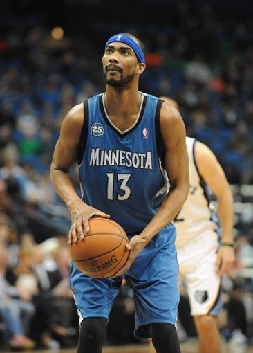 Apr 2, 2014; Minneapolis, MN, USA;  Minnesota Timberwolves forward Corey Brewer (13) prepares for a free throw in the second half against the Memphis Grizzlies at Target Center. The Wolves defeated the Grizzlies 102-88.  Mandatory Credit: Marilyn Indahl-USA TODAY Sports