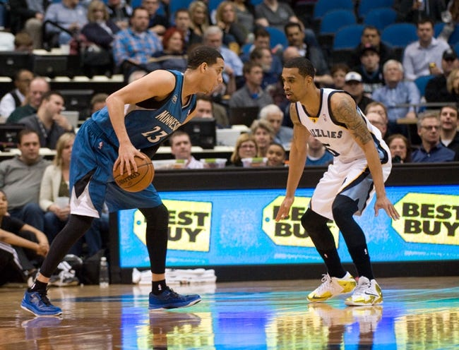 Apr 2, 2014; Minneapolis, MN, USA;  Minnesota Timberwolves guard Kevin Martin (23) challenged by Memphis Grizzlies guard Courtney Lee (5) in the first half at Target Center. The Wolves defeated the Grizzlies 102-88.  Mandatory Credit: Marilyn Indahl-USA TODAY Sports