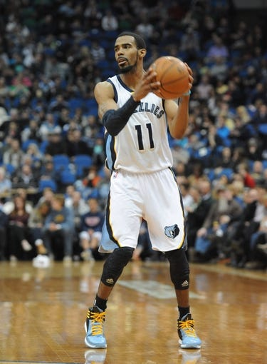 Apr 2, 2014; Minneapolis, MN, USA;  Memphis Grizzlies guard Mike Conley (11) in the first half against the Minnesota Timberwolves at Target Center. The Wolves defeated the Grizzlies 102-88.  Mandatory Credit: Marilyn Indahl-USA TODAY Sports