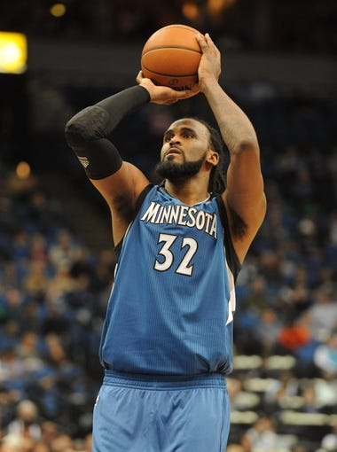 Apr 2, 2014; Minneapolis, MN, USA;  Minnesota Timberwolves center Ronny Turiaf (32) prepares for a free throw in the second half against the Memphis Grizzlies at Target Center. The Wolves defeated the Grizzlies 102-88.  Mandatory Credit: Marilyn Indahl-USA TODAY Sports
