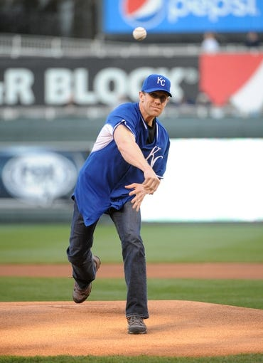 Apr 8, 2014; Kansas City, MO, USA; NASCAR driver Carl Edwards throws out the first pitch before the game between the Kansas City Royals and Tampa Bay Rays at Kauffman Stadium. Mandatory Credit: John Rieger-USA TODAY Sports