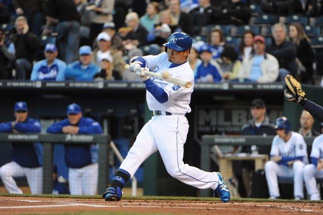 Apr 8, 2014; Kansas City, MO, USA; Kansas City Royals right fielder Norichika Aoki (23) hits a single against the Tampa Bay Rays in the first inning at Kauffman Stadium. Mandatory Credit: John Rieger-USA TODAY Sports